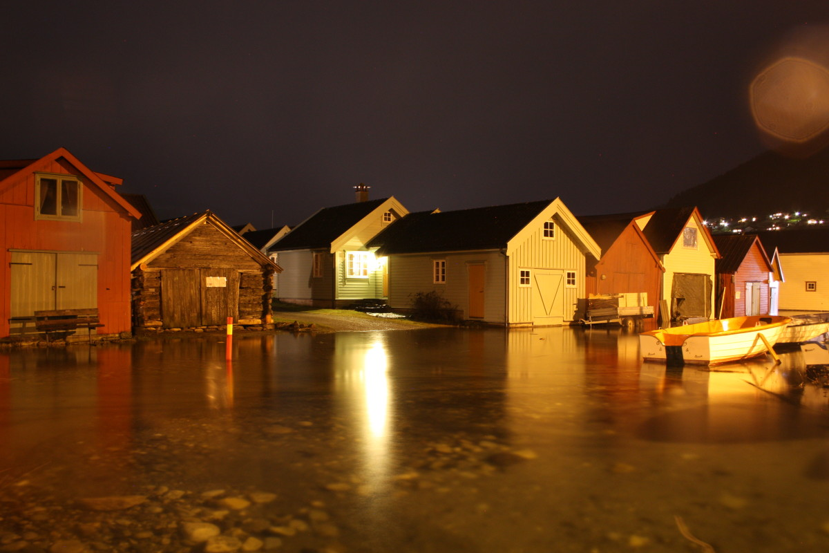 Boathouses in Vikøyri at night